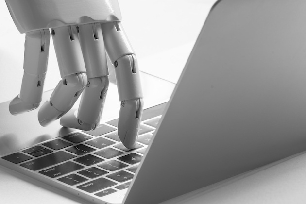 Evolution of Bots Blog - Robot Hand on Keyboard